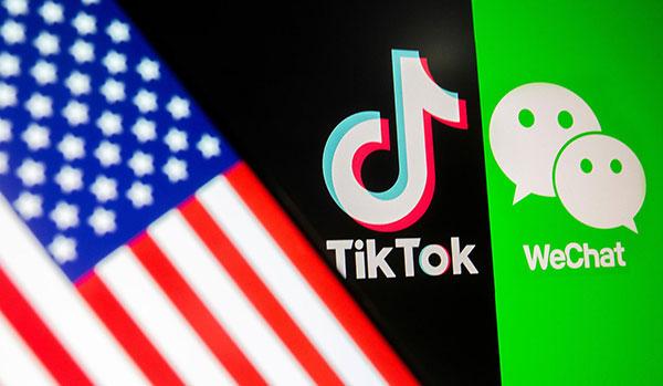 资料图片:2020年9月18日,手机上的美国国旗和WeChat、TikTok标识。