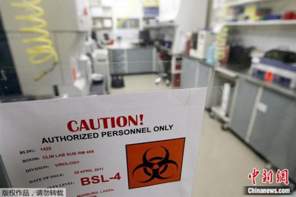 资料图:美国马里兰州德特里克堡,美国陆军传染病医学研究院实验室门上的标识。